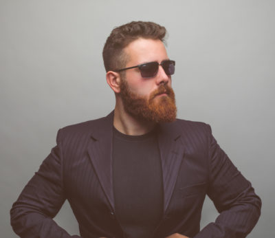 man benefiting from beard oil