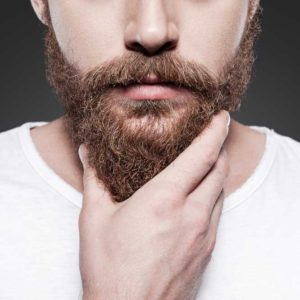 man using beard growth products