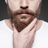 man using beard growth supplements
